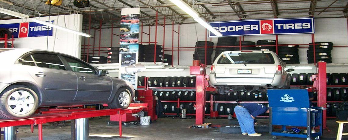Cars on lifts at south florida tire company